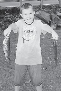 YOUNG ANGLER — Kyler Sexton, 9, of Isom, son of Jackie Sexton and Derenda Combs, caught these beauties in the Kentucky River at Isom. He is the grandson of Jack Wayne, Doris Sexton, and Buford and Tina Combs.