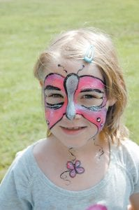 Seven-year-old Hannah Boggs of Partridge had a butterfly painted on her face Aug. 7 at the Whitesburg walking track during a benefit concert for Phillip McCray, a Letcher County Central High School student who was recently diagnosed with Hodgkin's lymphoma. Donations can be made to a special fund in Phillip McCray's name at Whitaker Bank in Whitesburg.
