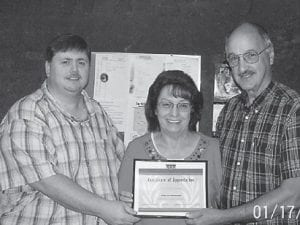 """APPRECIATION — Howard Standfield (right) of the Letcher County Farm Bureau Federation presents a certificate of appreciation to Kevin Day and Shirley Sexton of WXKQ for providing time on its """"Tuesday Morning Round Table"""" for health and safety issues. The time given by the radio station has allowed the Letcher County Farm Bureau Federation to receive the Health and Safety Award for the past three years."""