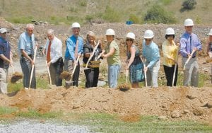 BREAKING GROUND — Participating in a groundbreaking ceremony on Aug. 6 for the new Letcher County Area Technology Center are (from left) Magistrate Codell Gibson, Terry Sturgill, school district director of special projects; the Rev. Elwood Cornett, Roger Martin, school district director of finance; Assistant Supt. Twyla Messer, Emily Kincer, Supt. Anna Craft's daughter; Ginny Kladis, Aaron Kincer, Craft's son; Barbara Ison, retired principal of the Letcher County Area Technology Center; and Danny Vance, principal of the Letcher County Area Technology Center.