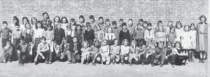 THIRD GRADE — Pictured is Miss Kilgore's Whitesburg Elementary School third-grade class in 1945. Front row, left to right, are Jimmie Giles, Jimmy Paul Enlow, Sharon June Williams, Don Hughes, Franklin Holland, Roscoe Hogg, Gloria Holstein, Alene Halcomb, Charlene Adkins, Arbadella Pigman, Lucille Ison, Joan Baker, Sarah Williams, Bert Francis, 'Buddy' Glen Reed Fields, Oscar 'Pepper' Marcum, unknown, (second row) Gene Bates, Mickey Raleigh, Shirley Profitt, Linda Darnell, Ann Cox, Basil Hall, Elizabeth Blair, unknown, unknown, James Cornett, Carlene Hogg, unknown, Gail Potter, Harlan Collins, Janet Combs, Patricia Gay Martin, unknown, (third row) Archie Joe Fields, unknown, Ellen Mullins, Alberta Stamper, Margaret Collier, Pauline Ison, Edna Mae Bates, Don Nolan, Orville Ray Sexton, Ernest Cook, Bert Back, unknown, Donald Barker, RT. Holbrook, unknown, John Edward Collins, Arlie Jo Kincer, Wallen Enlow, Rosa Brown, Thelma Morton, and Miss Kilgore.