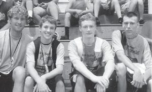 BASKETBALL CAMPERS — Three basketball players and a coach from Letcher County Central High School attended Rick Bolas Blue Chip Camp this summer at Georgetown. Pictured (left to right) are Junior Varsity Coach Winston Lee, Colton Collins, son of Shane and Trina Collins of Smoot Creek; Sam Robinson, son of David and Bonita Robinson of Kona; and Kendall Ballou, son of Kenny and Kim Ballou of Billmoore Branch. Ballou was the winner of the Blue Chip dunk contest.