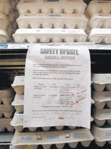A sign warns customers of the recall of certain lots of eggs that had been previously sold at a supermarket in Los Angeles. A salmonella outbreak that sickened hundreds and led to the recall of hundreds of millions of eggs from one Iowa firm will likely grow, federal health officials said. (AP Photo)