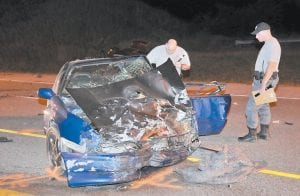 Police examined one of two vehicles involved in a fatal collision Monday night on U.S. Highway 23, near the Kentucky-Virginia state line. Police say John Caudill, 30, and Michael Gullett, 36, were killed when the two vehicles collided as Gullett was driving south in the northbound lane. (Photo by Chris Anderson)
