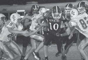 CAVS FALL TO 0-2 — Jenkins quarterback Eric Smith broke through the Allen Central defense early during the Cavaliers' 42-0 loss on Friday night. Jenkins fell to 0-2. (Photo by Chris Anderson)