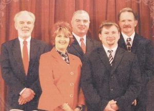 """John Caudill, second from right, is seen in this image taken from the cover of an album by """"The Master's Harmony,"""" a gospel music band in which he played bass guitar."""