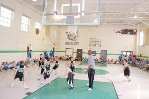 TEACHABLE MOMENT — Jules Camara, who played basketball at the University of Kentucky from 2000 to 2003, scrimmaged with the middle school team at Arlie Boggs Elementary School last week while members of the student body looked on. (Photos by Sally Barto)