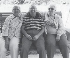 JUST A'SWANGING are Lizzie M. Wright, Jim Craft and Margaret Pease.