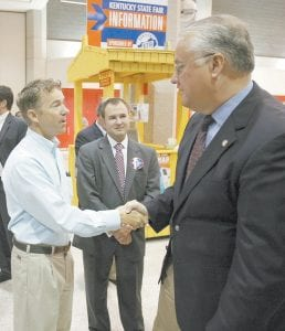 Republican U.S. Senate candidate Rand Paul, left, is seen here shaking hands with state Senate President David Williams, R-Burkesville, at the Kentucky State Fair in Louisville recently. (AP Photo/Ed Reinke)