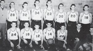 1956-57 YELLOW Jackets — Front row, left to right: 24 Sonny Webb, 16 Tommy Fields, 12 Chester Adams, 14 Wendell Meade, 26 Larry Britton, Managers Roddy Caudill and Chad Back, back row: Coach Ernie Trosper, 28 Don Sumpter, 32 Darrel Stidham, 34 Darrell Sturgill, 22 Marty Blair, 30 Ercel Sturgill, 20 Robert Wright, and 18 Lloyd Hodge.