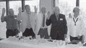 NEW OFFICERS — A new slate of officers was sworn in at a meeting of the Kentucky River Area Development District Board of Directors on August 25. From right to left are the new officers are Mayor Veda Wooton, chairman; Judge Jimmy Sizemore, vice-chairman; Mayor James W. Craft, treasurer; Judge/Executive Jim Ward, secretary; and Dale Bishop, parliamentarian.