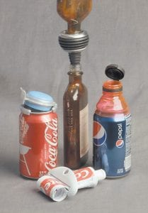 This photo shows the Fizz-Keeper, left, EZ-Funnel, center, Bottle Top, right, and Squeezeit, foreground. (AP Photo)