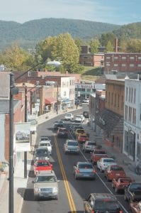 This view of downtown Whitesburg was taken last week from the bucket of a fire truck as members of the Whitesburg Fire Department hung new banners on Main Street. The banners depict diff erent landmarks located in Letcher County.