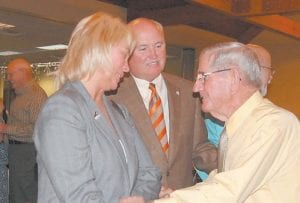 """State Rep. Leslie Combs and State Sen. Johnny Ray Turner congratulate Maynard Hogg (right) for receiving a business achievement and leadership award at the Letcher County Chamber of Commerce's """"Unsung Heroes"""" award banquet held Sept. 9 at Pine Mountain Grill in Whitesburg."""