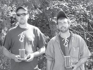 TOURNEY WINNERS — Finishing first in the Isom Days Horseshoe Tournament were (above) Eddie Stacy and Adam Stacey. Jody Mitchell and Tim Mitchell were second, and Steve Cornett and Pauline Cornett were third. Alvin Slone had the most ringers. In the Corn Hole Tournament, the winners were (below) Estill Sizemore and Kenneth Combs. Finishing second were Lonnie Johnson and Don Hall, and third were Jack Hopkins and Ricky Calhoun.