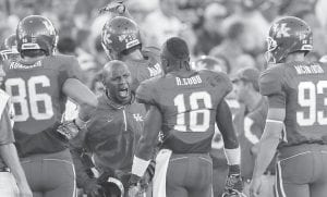 Kentucky coach Joker Phillips addressed his team during a timeout in their NCAA college football game against Akron in Lexington on Sept. 18. (AP Photo/Ed Reinke)