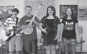 YOUNG MUSICIANS from the Cowan Music School played at the Ermine Senior Citizens Center. Pictured are Levi Caudill, Logan Dollarhide, Rebecca Stanifer, and Autumn Dollarhide.