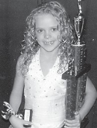 TINY MISS MOUNTAIN HERITAGE for 2010 is Kaci Nicole McCown, 7, daughter of Oscar and Tonya Mc- Cown of Isom, and sister of Dalton McCown, 11. She is the granddaughter of Doris McCown of Eolia and the late Larry McCown, and Roger and Katy Stephens of Isom. She is a second-grade student at West Whitesburg Elementary School.