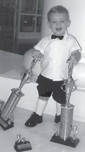 PAGEANT WINNER — Jace Taylor Bates, son of Justin 'J.J.' and Rhiannon Bates, won first place and most photogenic in the Mountain Heritage Baby Pageant on Sept. 13 in the 13018 months category. He is the grandson of Bobby Howard of Henryville, Ind.; Lewis and Jolean Fugate of Isom; J.H. and Thelma Bates of Whitesburg; and Connie Bates, also of Whitesburg. His greatgrandparents are the late John and Thelma Howard; Leslie and Shirley Dixon of Cornettsville; Pauline Bates of Whitesburg and the late Noble Bates; Janice Vance of Whitesburg; and Edward 'Bubby' Vance of Rutledge, Tenn.