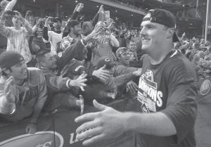 BRUCE HITS WALKOFF HOMER TO CLINCH TITLE — Cincinnati's Jay Bruce celebrated on the field after the Reds defeated the Houston Astros 3-2 on Tuesday night to clinch the NL Central. Bruce hit a walkoff home run to win the game. (AP Photo/Tom Uhlman)
