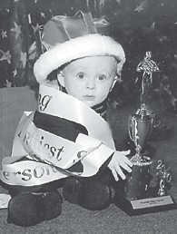 PAGEANT WINNER — Joe Don Pratt Jr. was crowned King of the Riverside Days Pageant on Aug. 9. He competed in the 6-12 months category. He was chosen for prettiest eyes, prettiest smile, and best personality, and received trophies as King and most photogenic. He won the Mountain Heritage Baby Pageant on Sept. 13 in the 7-12 months male category, and also was named most photogenic and received two trophies. He is the 10-month-old son of Joe and Marie Pratt of Craft's Colly, and has two older sisters, Taylor, 10, and Trinity, 6. His grandparents are Rita Pratt and Goldie and Glenn Triplett, all of Jenkins, and John and Sharon Pratt of McRoberts. He is the greatgrandson of Anna Wyatt, also of Jenkins.