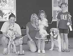 BEST IN SHOW — The winners of Best in Show at the Mountain Heritage Dog Show on Sept. 19 were (left to right) Thoven with Angela Mosley, first; Angel with Kylee Yonts, second; and Chocka with Bella Back, third.
