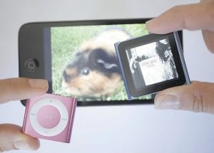 Shown are new Apple iPods from left, Touch and the Shuffle.