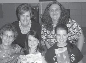 """FAMILY LITERACY — Burdine Elementary School recently hosted a Family Literacy Night with author Andrea Cheng. Activities included classroom projects, Cheng reading her book """"The Lemon Sisters"""" to students, and refreshments. Winners of a book by Cheng were Jaley Caudill and Lindsey Belcher. Pictured are (top row, left to right) Principal Gracie Maggard, Librarian Lynn Cox, (bottom row) Andrea Cheng, Jaley Caudill, and Lindsey Belcher."""