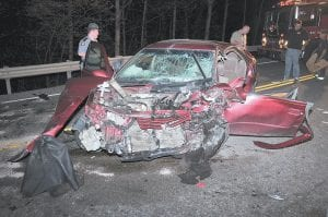 A badly damaged Toyota Camry sat on U.S. 119 at Payne Gap on October 1 after a serious accident resulted in two people being airlifted to Tennessee hospitals for treatment. Letcher County Sheriff 's Deputy Brian Damron said he believes drug use by the Camry's driver, Crystal Barlow, caused the wreck which left Barlow, of Isom, and Teddy Thompson, of Burdine, seriously injured. (Photo by Chris Anderson)