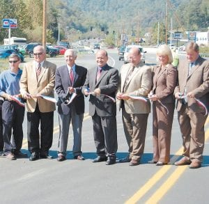 RIBBON-CUTTING CEREMONY — State and local officials gathered at KY 15 on Sept. 29 to celebrate the completion of improvements to a formerly congested stretch of roadway including a continuous turn lane and the widening of two bridges. Pictured from left are Chuck Childers, Whitesburg section engineer for Kentucky Transportation Cabinet District 12, State Sen. Johnny Ray Turner, Gov. Steve Beshear, Kevin Damron, chief district engineer for KTC District 12, Keith Damron, KTC Division of Planning director, State Rep. Leslie Combs and Letcher County Judge/Executive Jim Ward.