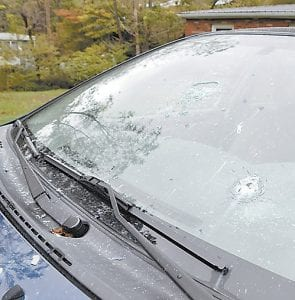 SHOT UP CAR — A 2007, navy blue Toyota Corolla owned by Dixie Hall was riddled with bullet holes after someone went on a shooting spree in Low Gap Branch of Little Colley around 1:30 a.m. on Oct. 4.