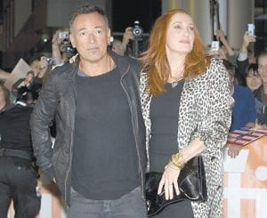 """Bruce Springsteen and wife Patti Scialfa were photographed arriving for the gala premiere of the film """"The Promise: The Making of Darkness on the Edge of Town"""" at the 2010 Toronto International Film Festival in Toronto recently. (AP Photo/The Canadian Press)"""