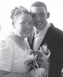 MARRIED — Mikie Jones and Eugene Halcomb were married August 9 at Kingdom Come Park at Gordon. The bride is the daughter of Marlene and Larry Jones of Long Fork, and the granddaughter of Bruce Jones of Linefork and Trill and Marlon Cornett of Gordon. The bridegroom is the son of Preston 'Rabbit' Halcomb of Blackey.