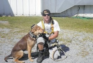 MAN, DOG SHOT TO DEATH — Mark Joseph Sturgill, 48, posed with his dog, Jake, when this photograph was taken recently and posted on Facebook two weeks ago. Both Sturgill and Jake were shot to death in Jenkins on October 7. Samuel Todd Collier, 32, has been held without bond since he was arrested October 7 and charged with murdering Sturgill. The case against Collier has been sent to the Letcher County Grand Jury.