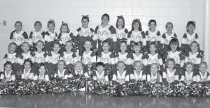 THE COWAN PUPS took second place in the crowd pleaser category in the Mountain Heritage Festival Parade. The Pups are the cheerleading squad at Cowan Elementary School and are coached by Tressany Howard, Shelley Banks, Cyndi Boggs, and Misty Lewis. Pictured are (back row, left to right) Shenoa Frazier, Kalya Eldridge, Maggie Webb, Mackenzie Craft, Lexi Peace, Becky Eldridge, Jamie Craft, Madison Fugate, Shelby Howard, Hailey Brown, Sydney Coots, (middle row) Mia Rouse, Harley Driskell, Kaylee Rae Banks, Bailey Smith, Madison Hurst, Grace McDougal, Loren Boggs, Haley Howard, Rylee Lewis, Mallory Miller, Summer Collier, Emily Stone, (front row) Alegih Lawson, Toni Adams, Kendra Morris, Skylar Frazier, Baylee Caudill, Anna Eldridge, Ashtin Caldwell, Shawna Frazier, Kensley Haley, Abigail McDougal, Sydney Craft, and Kaylee Banks. Not pictured are Erica Johnson, Shelby Turner, and Meghan Fields.