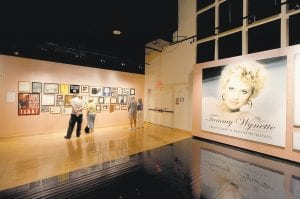"""Guests view various memorabilia at the """"Tammy Wynette: First Lady of Country Music"""" exhibit at The Country Music Hall of Fame in Nashville, Tenn. The exhibit runs through June 12, 2011. (AP Photo)"""
