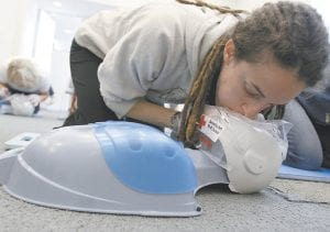 A woman practices a first aid response for CPR during a first aid/CPR/AED class at the Red Cross in Chicago in this file photo. (AP Photo)