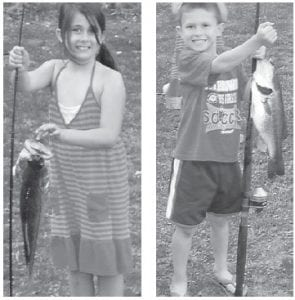 YOUNG ANGLERS — Madison and Brett Bradford caught these fish in their grandfather's pond while they were visiting during summer vacation. They live in Ripley, Ohio. Madison, 8, and Brett, 7, are the children of Adam and Martie Banks Bradford. Their grandparents are David and Millie Banks of Cowan, and Bill and Kathy Bradford of Maysville. Their great-grandparents are Panny Day Stallard of Kingscreek and the late Butler Day, and Bert and Zelma Lou Banks of Cowan and the late Catherine Banks. They have an older sister, Hannah, 16.