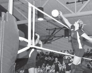 Lady Letcher Central's Lisa Frazier spiked the ball across the net as the Lady Cougars earned their sixth straight regional championship on Oct. 21. After handling Leslie County in the semi-final round, the perennial champs cruised past host Powell County with a pair of 25-13 winning sets. The Lady Cougars will play Region 12 champion Southwestern at Bellarmine University in Louisville on Friday at 7:15 p.m. (Photo by Chris Anderson)