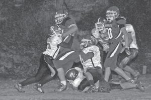 DAVID MEETS GOLIATH — Jenkins freshman Josh Puckett worked hard to contain a Betsy Layne rushing attempt in the Cavaliers' regular season-ending loss to the Bobcats. The Cavs lost 56-12 in the game to finish winless on the season. However, they will face Pikeville on Friday in the opening round of postseason football action. The game is at 7:30 p.m. at Pikeville. (Photo by Chris Anderson)