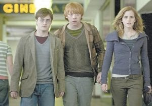 "HOLIDAY FILMS — Daniel Radcliff , Rupert Grint and Emma Watson are shown in a scene from, ""Harry Potter and the Deathly Hallows."" (AP Photo/Warner Bros.)"