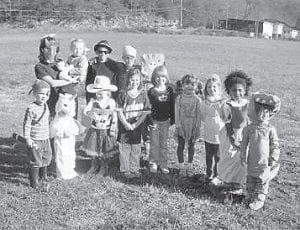COSTUME PARTY — ECCO's Kid's Time held a costume party on Oct. 29. The children sang pumpkin songs, made a treat box, and decorated cookies. Pictured are (left to right, back row) Hannah and Grace Long, Isaac Boulden, Caleb Broersma, Reuben Long, (front row) Kenan Broersma, Emily and Cammie Creech, Katie Sturgill, Deladis Holbrook, Lydia Broersma, Helen Long, Leah Boulden, and Boone Baldwin.