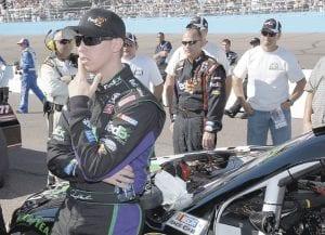 Denny Hamlin stood at his car before the NASCAR Sprint Cup Series auto race at Phoenix International Raceway on Sunday. (AP Photo)