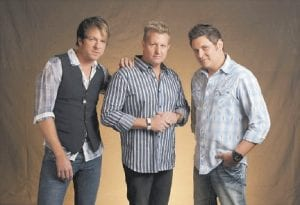 Joe Don Rooney, left, Gary Levox, and Jay DeMarcus, right, of Rascal Flatts are seen in this photo. After a decade as country music's top-selling group with nearly 20 million albums sold and one of its most popular touring acts, Rascal Flatts is starting the next decade as veterans on top, and in transition. (AP Photo)