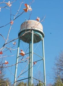 LANDMARK COMING DOWN AFTER 54 YEARS — This water tower formerly used by the Whitesburg Appalachian Regional Hospital will be torn down in the near future. The tower, which sits atop Tunnel Hill, was built in 1956, the same year the hospital opened, and was used until about 10 years ago. It has since become a safety hazard. (Photo by Sally Barto)