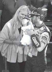NASCAR driver Jimmie Johnson, right, held his daughter Genevieve Marie as his wife Chandra looked on after Johnson won the NASCAR Sprint Cup Series Championship Sunday. (AP Photo)