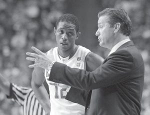 Kentucky guard Brandon Knight listened to coach John Calipari during the second half of Kentucky's 91-57 win in an NCAA college basketball game against Boston University in Lexington on Tuesday night. Knight had 23 points. (AP Photo/Ed Reinke)
