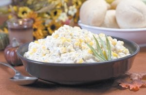 With plenty of dairy to make it nice and creamy this creamed corn recipe will be a stand-out side at the holiday table. (AP Photo/Larry Crowe)