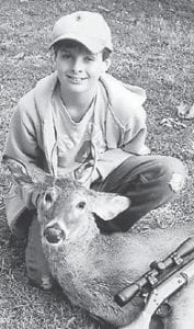 YOUNG HUNTER — Cameron Adams killed his first deer Nov. 20. He celebrated his 13th birthday Nov. 27 at his home with family and friends, and is a student at Letcher Elementary School. He is the son of Larry and Lynn Adams of Isom.