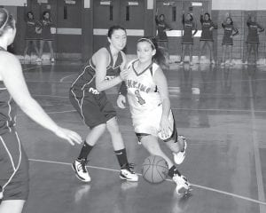 LADY CAVS OFF TO 1-1 START — Jenkins freshman guard Mercedes Boggs drove the ball to the goal during the Lady Cavaliers' 78-67 loss to Leslie County on Dec. 3. The Lady Cavs are 1-1 on the season so far and will face off Knott Central tonight (Wednesday) at home before continuing 53rd District play Thursday at June Buchanan. (Photo by Chris Anderson)